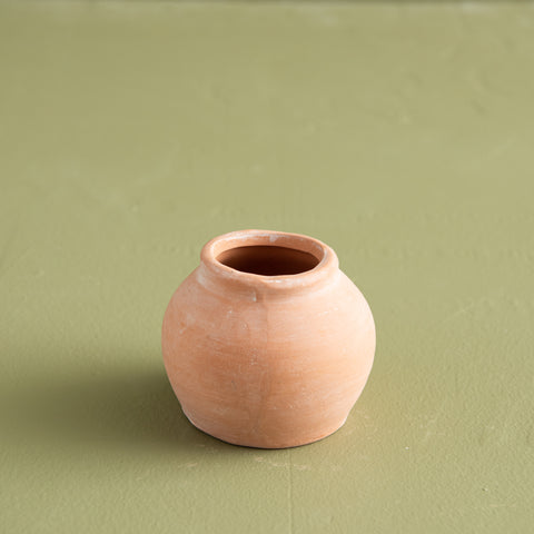 orb shaped terracotta jar vase