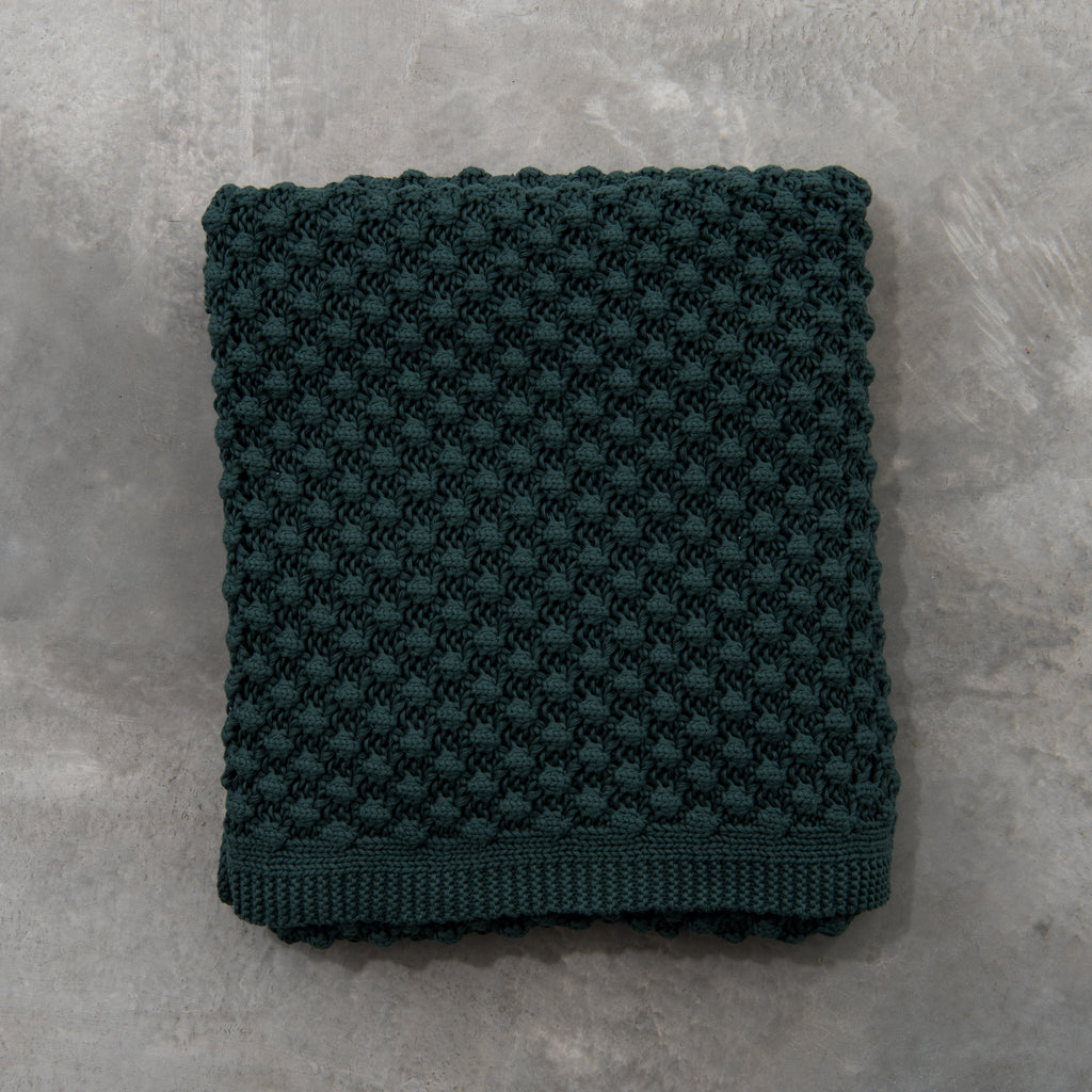 dark green knitted throw