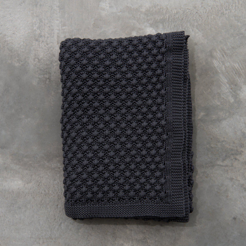 dark grey knitted throw