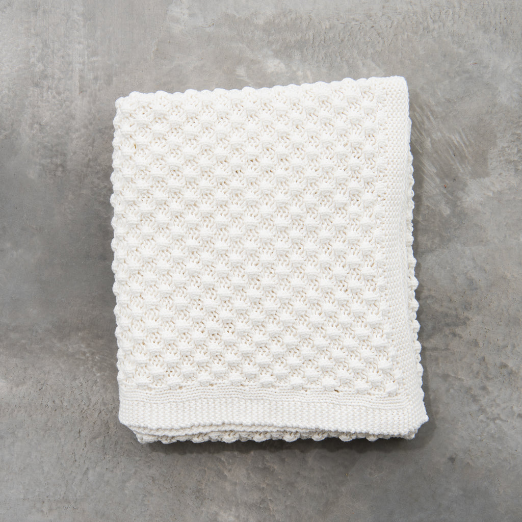white knitted throw