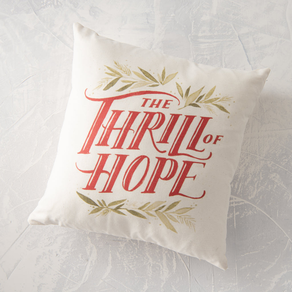 "cream holiday pillow with phrase ""the thrill of hope"""