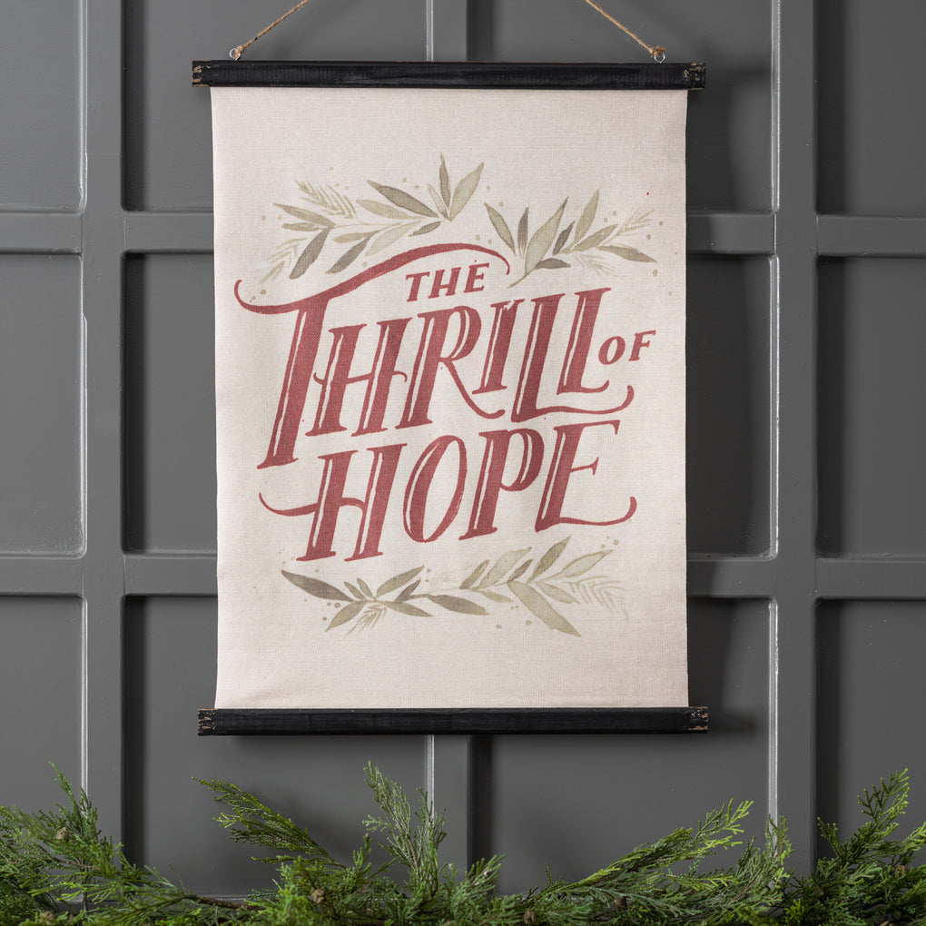 "hanging christmas wall scroll that reads ""the thrill of hope"""