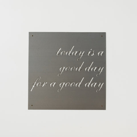 "metal quote sign that reads ""today is a good day for a good day"""