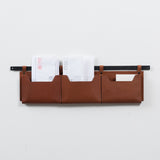 triple leather wall organizer on black metal bar