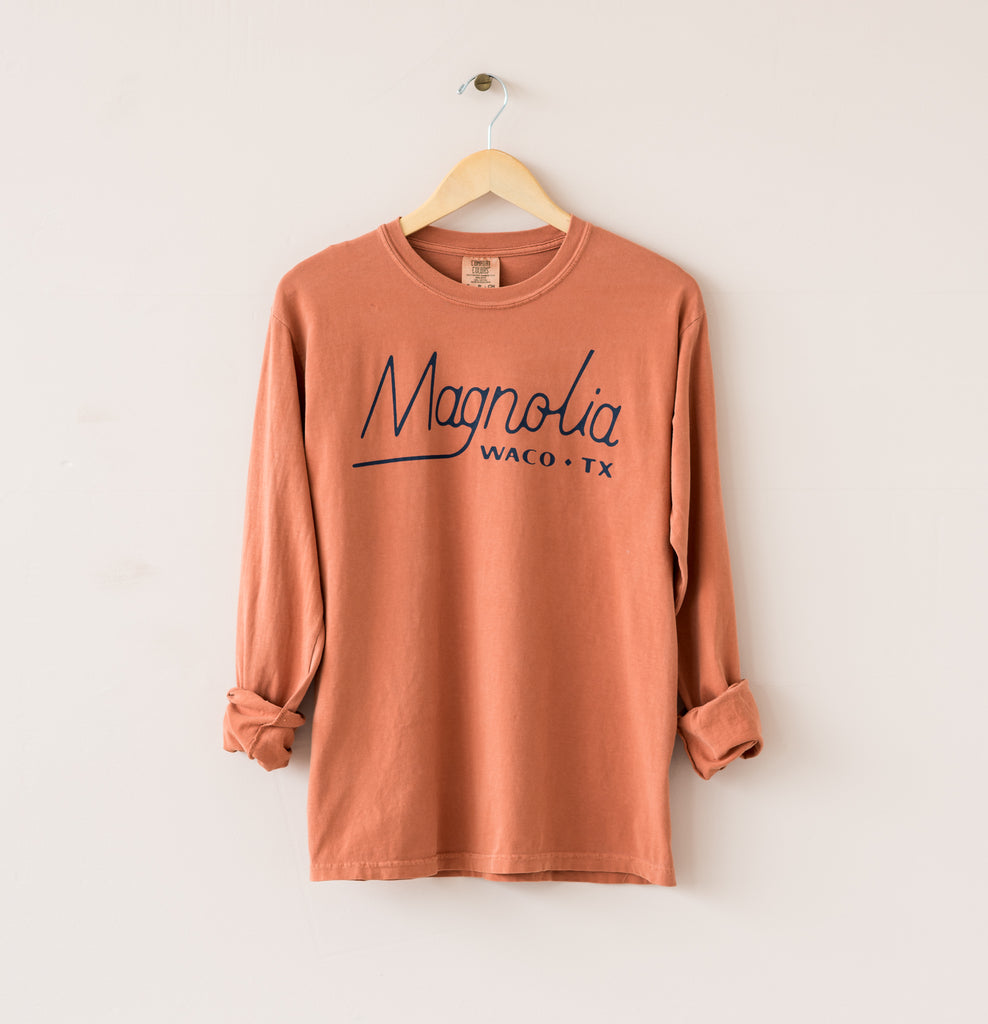 muted orange cotton long sleeve shirt with retro magnolia logo on front