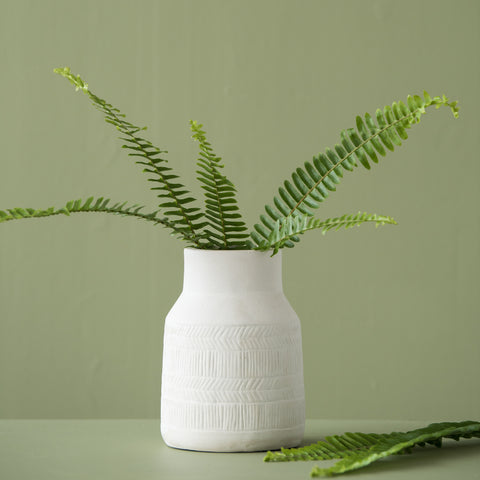 modern white ceramic vase with herringbone pattern