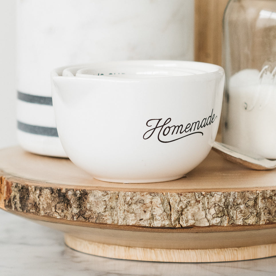 "white ceramic measuring cups with ""homemade"" script"
