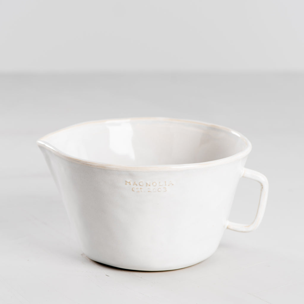 white ceramic mixing bowl with spout and handle