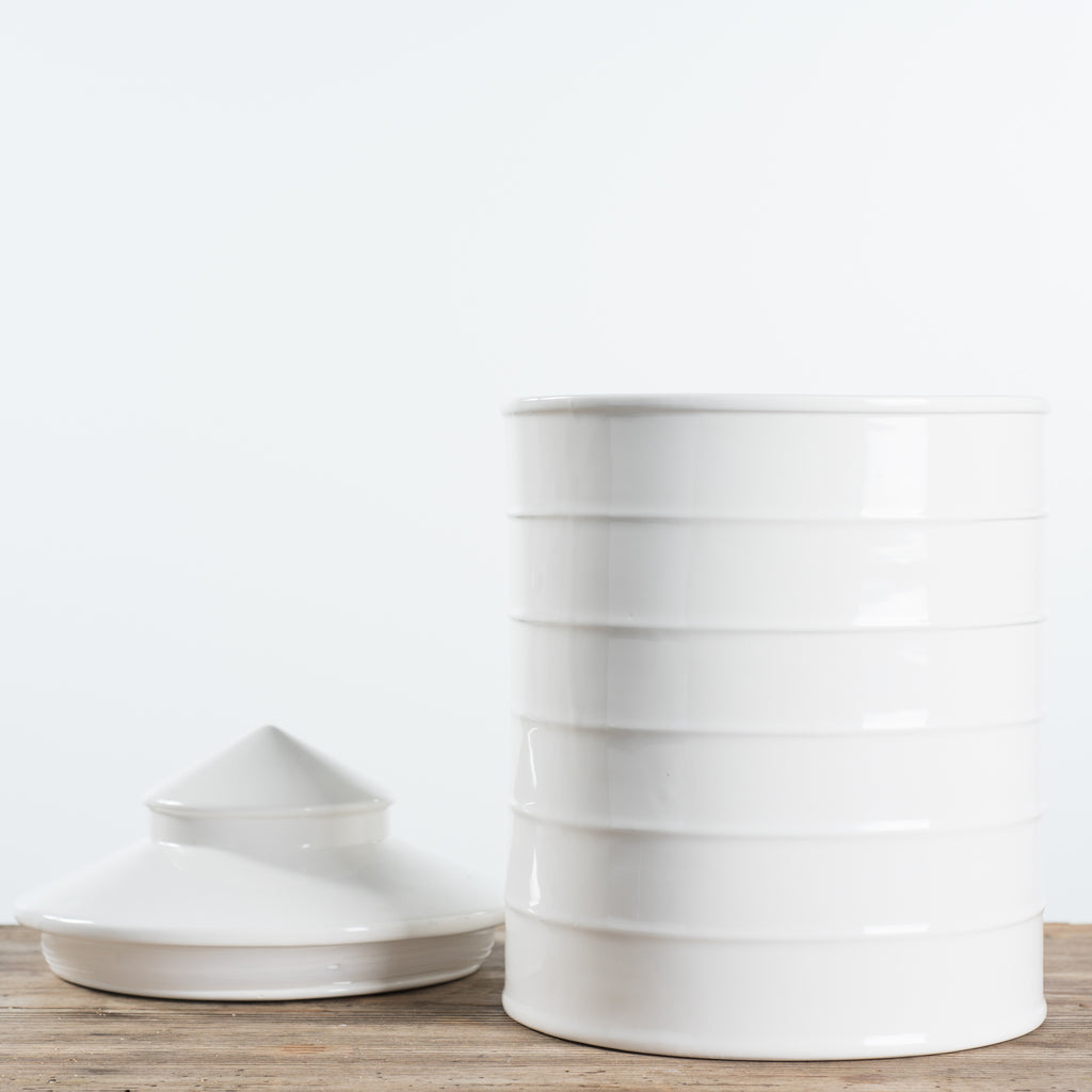 white ceramic cookie jar shaped like a silo