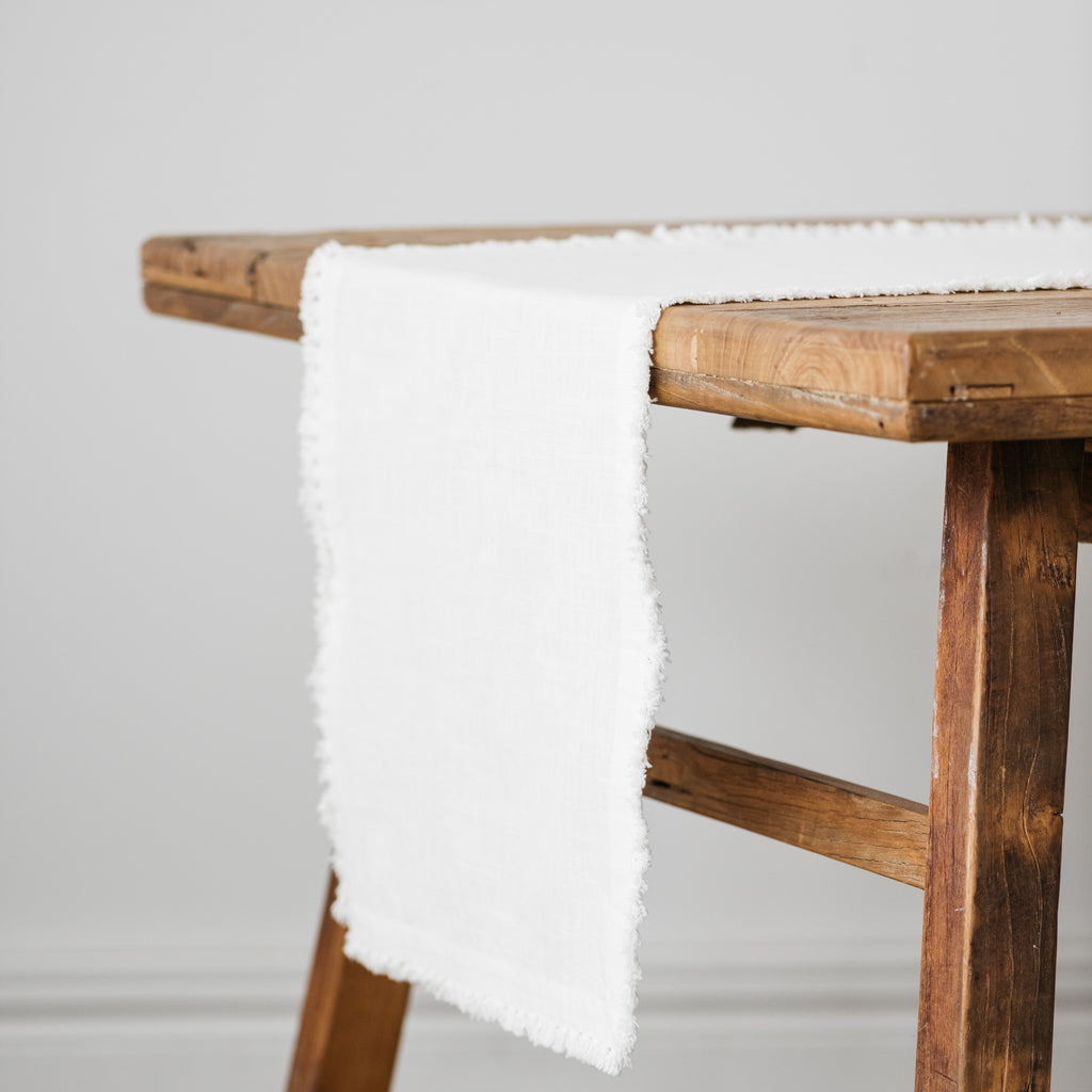 white cotton table runner with tassels