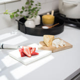 white marble and wood split serving board