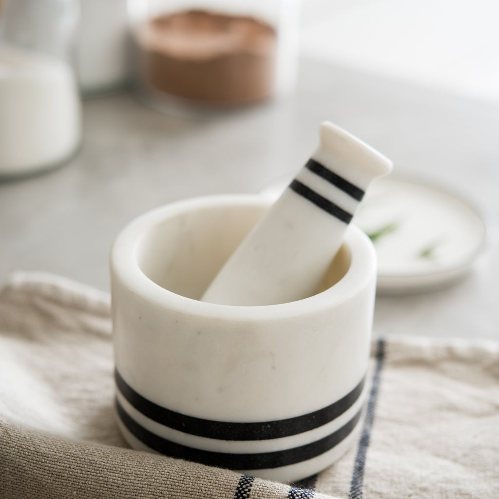 white marble mortar and pestle with black stripes