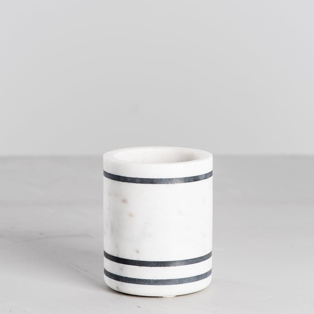 white marble utensil holder with black stripes
