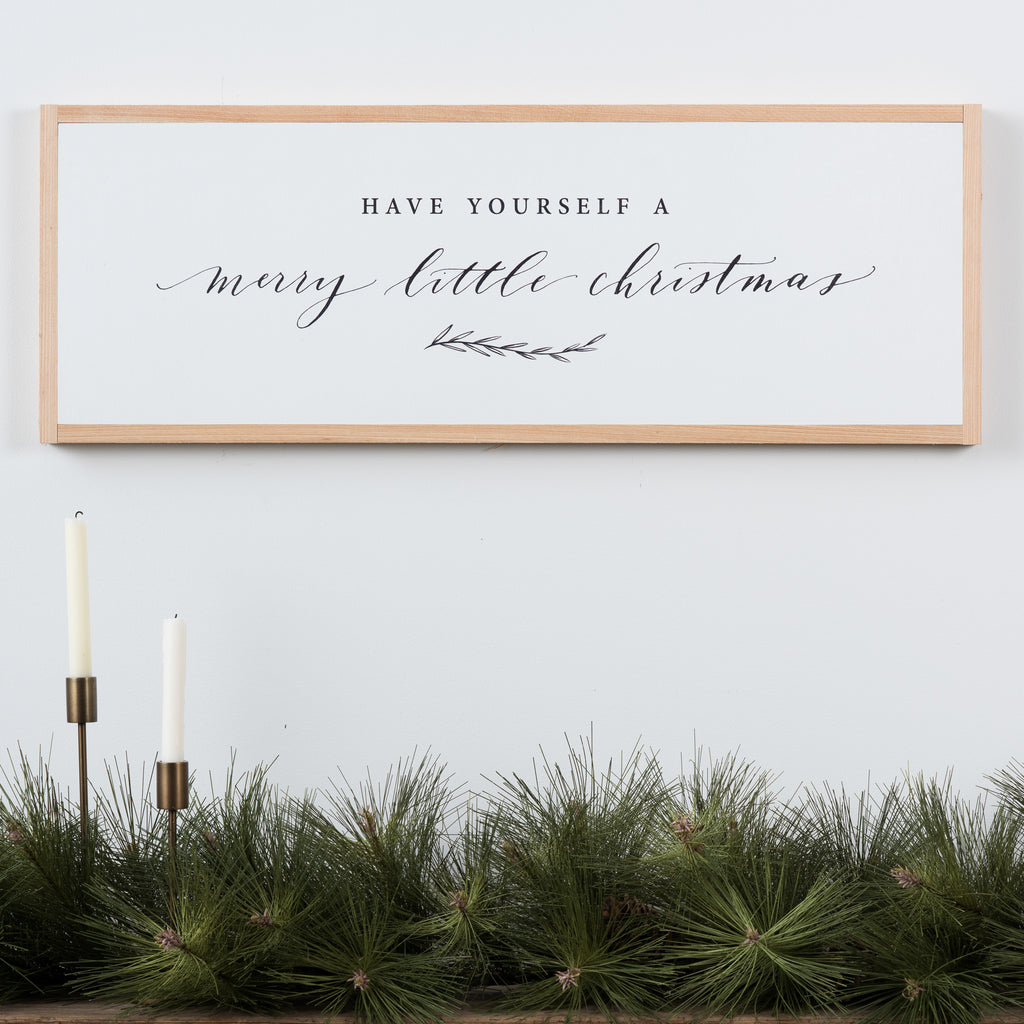 "white wooden wall sign that says ""have yourself a merry little christmas"""