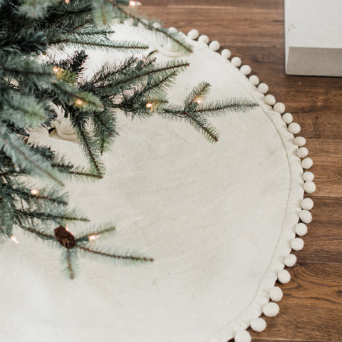 white tree skirt with pom pom edge