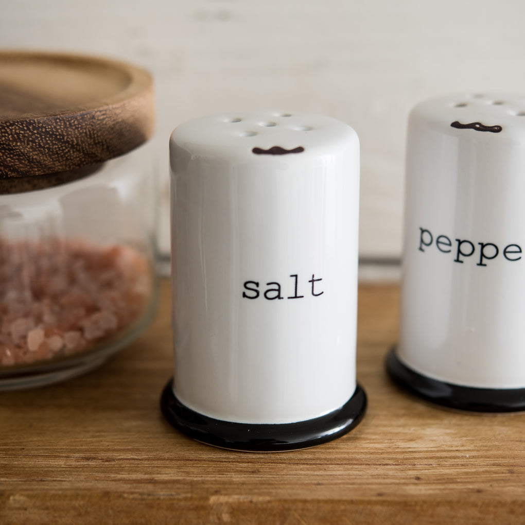 white stoneware salt and pepper shakers
