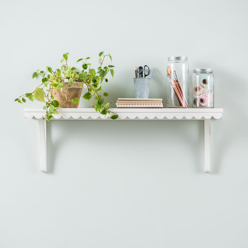 large white wooden wall shelf with scalloped edge