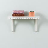 medium white wooden wall shelf with scalloped edge