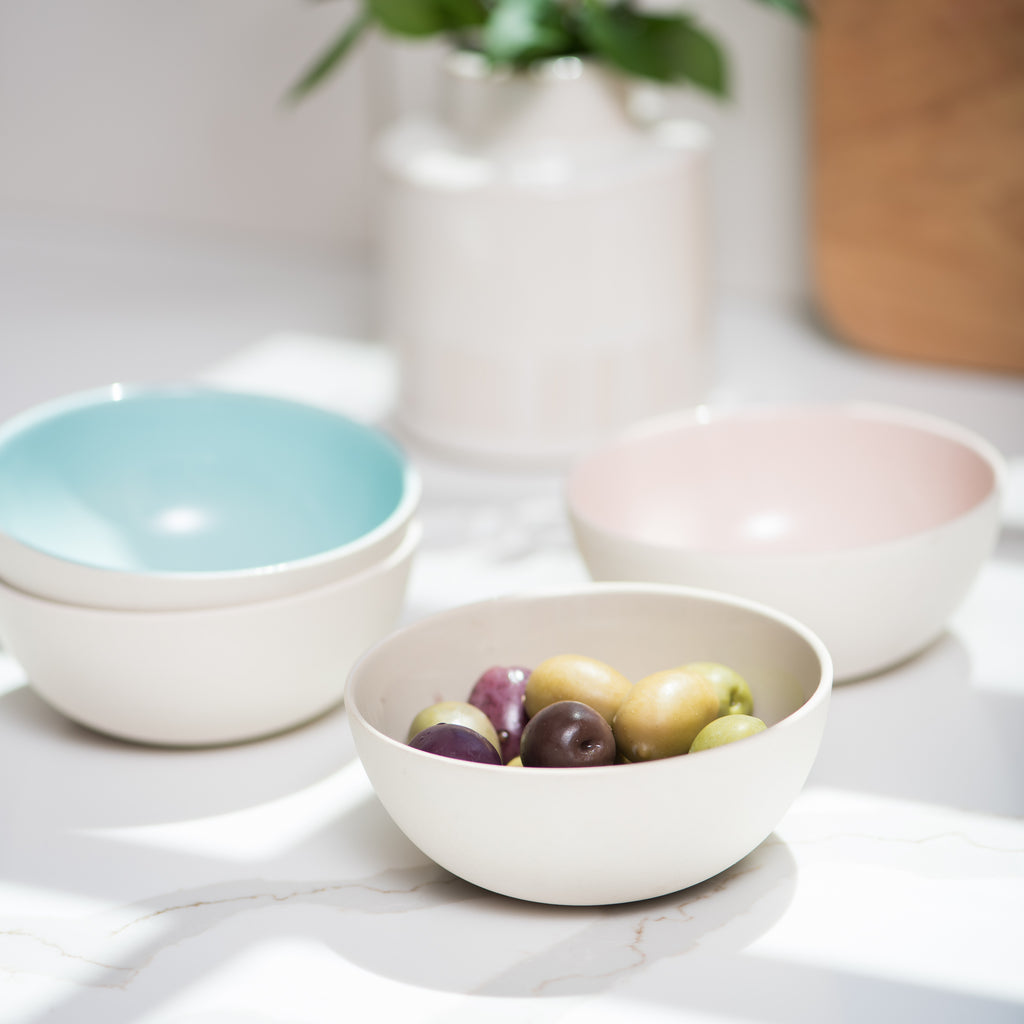 small white bisque bowl with blue interior
