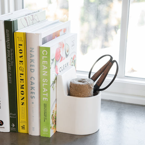 white ceramic cup bookend set