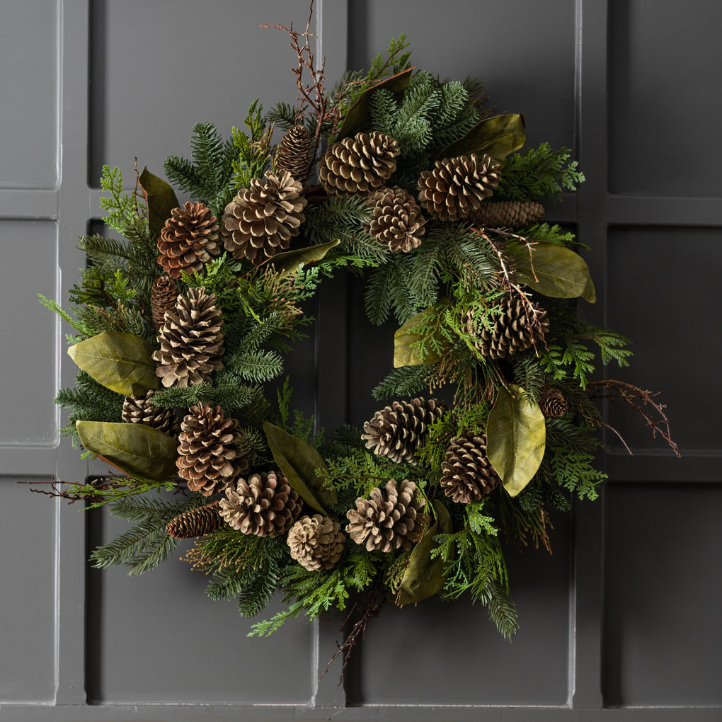 artificial evergreen winter wreath with pine cones