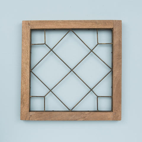 decorative wooden window pane with brass interior detail