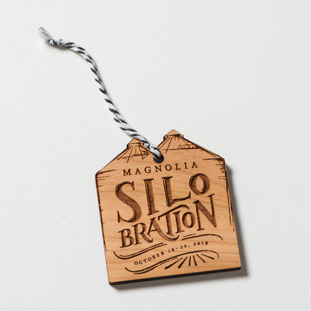 wooden silobration ornament with string hanger