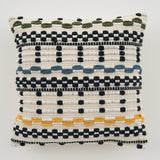 woven navy and white textured pillow with colored detail