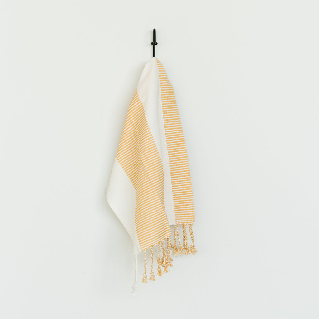 white and yellow cotton striped tea towel with tassels