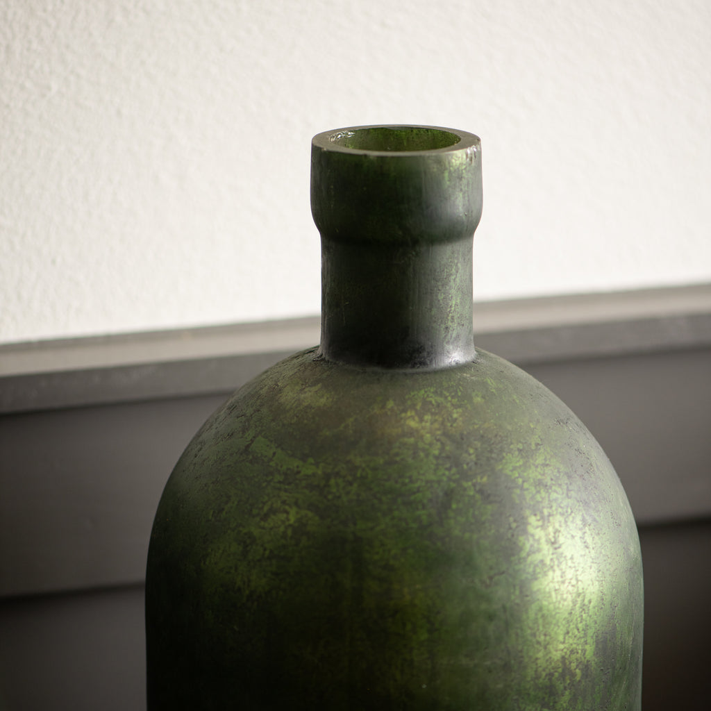 green glass vase with metallic finish