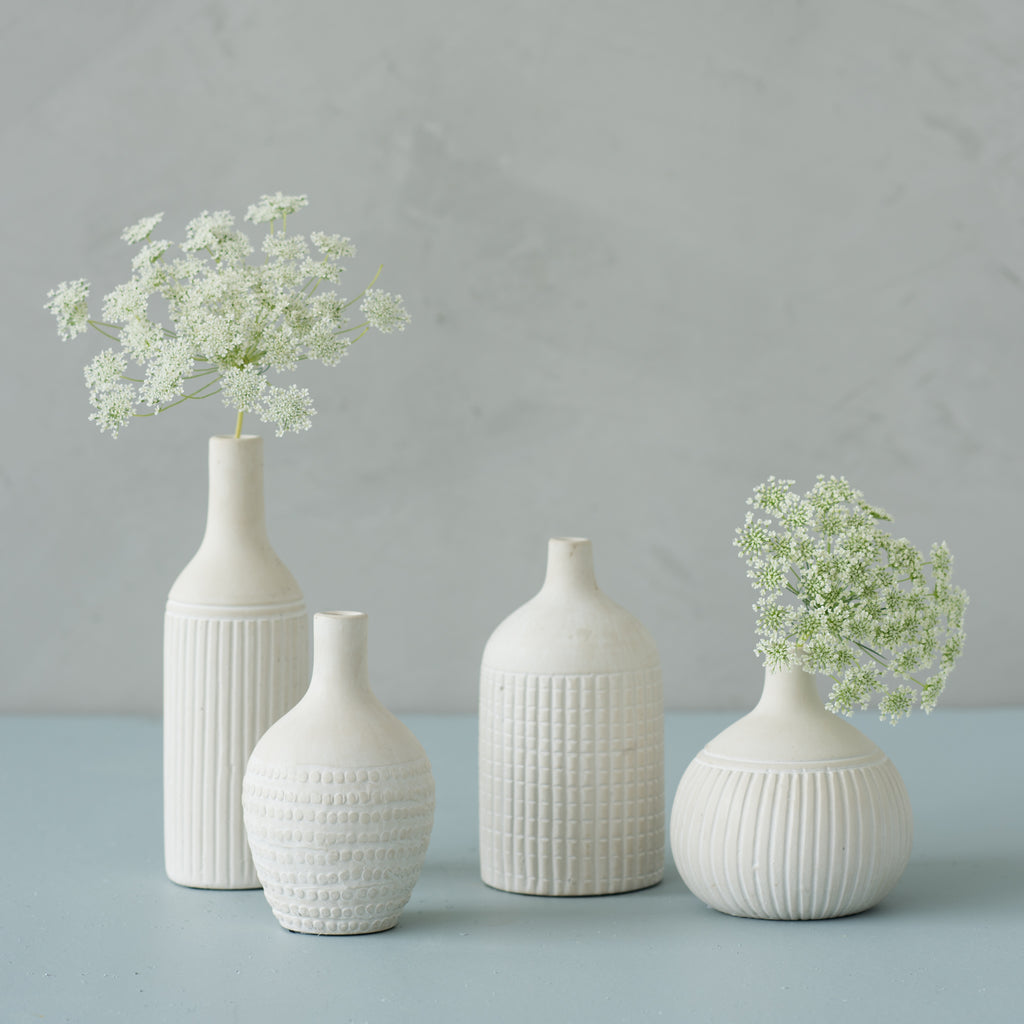 white ceramic bud vase with matte finish