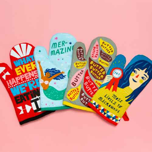 A variety of funny, colorful oven mitts with fun phrases on them