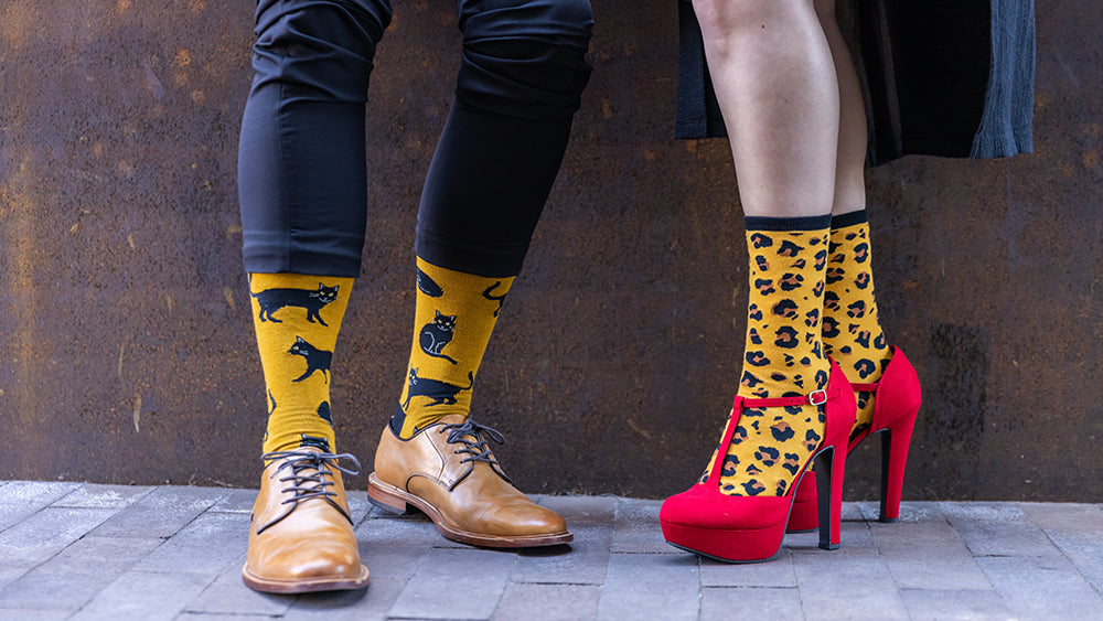 man and woman showing off bold, crazy socks