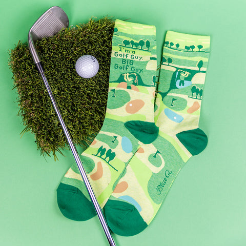 """men's socks showing.a golf course and the words, """"I'm a golf guy. Big golf guy."""""""