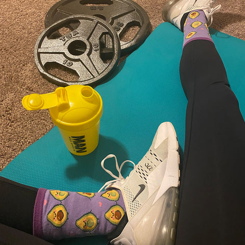 woman wearing fun food socks with workout shoes