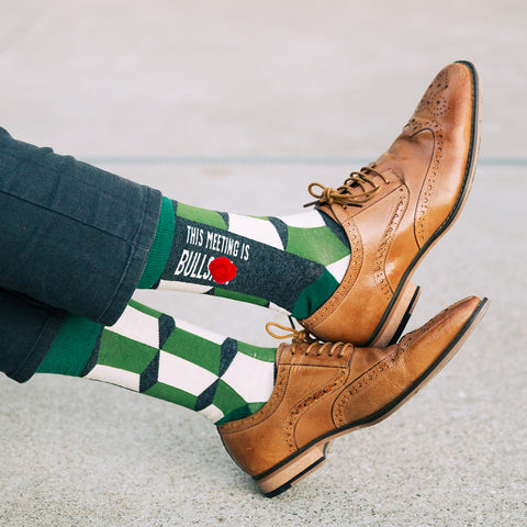 Man wearing This Meeting is Bullshit socks with dress shoes