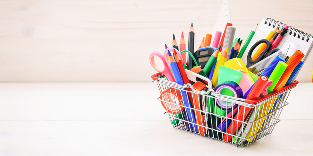 School supplies in a shopping basket
