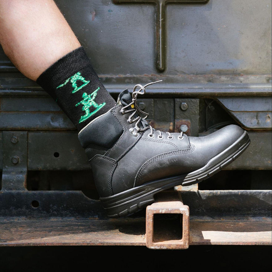 a person modeling an army men awesome novelty sock in a boot
