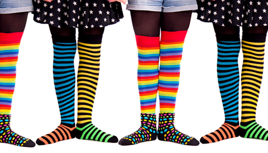 people lined up wearing bright socks