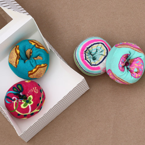 """sock """"donuts"""" in a bakery box"""