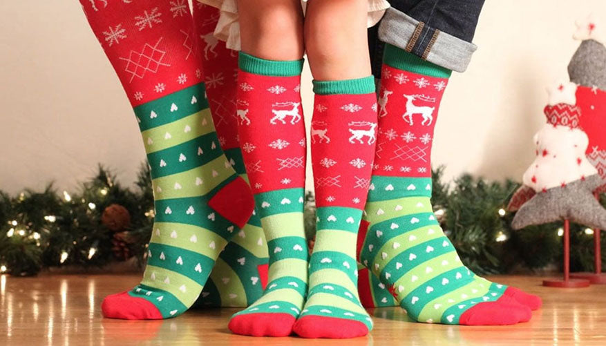 family wearing matching holiday themed socks