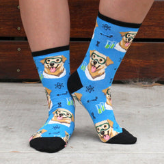 "A woman wearing funny ""science lab"" socks with a dog wearing chemistry safety goggles"