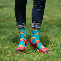 A woman wearing fun burger socks with red heeled sandals