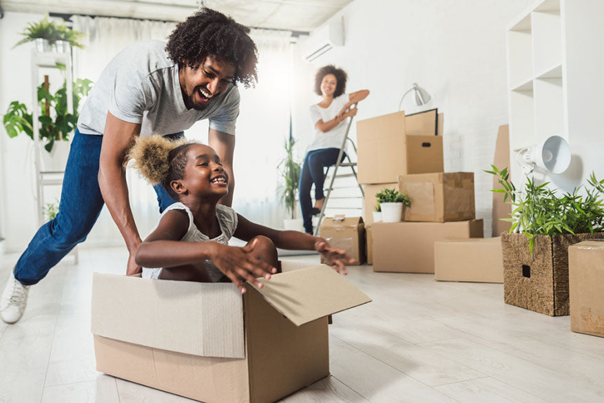 happy african american family unpacking