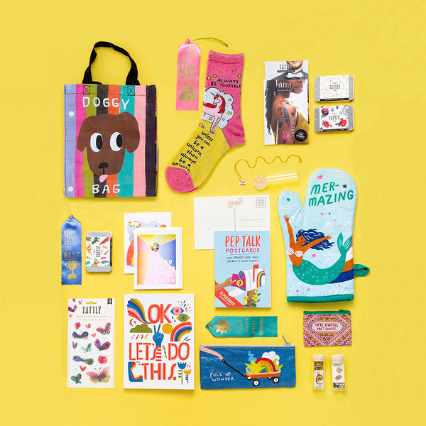 A variety of fun gift products like tote bags, oven mitts, journals, jewelry and temporary tattoos