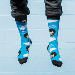 A man wearing Bob Ross socks with clouds