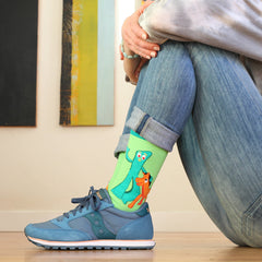 A woman wearing funny Gumby socks