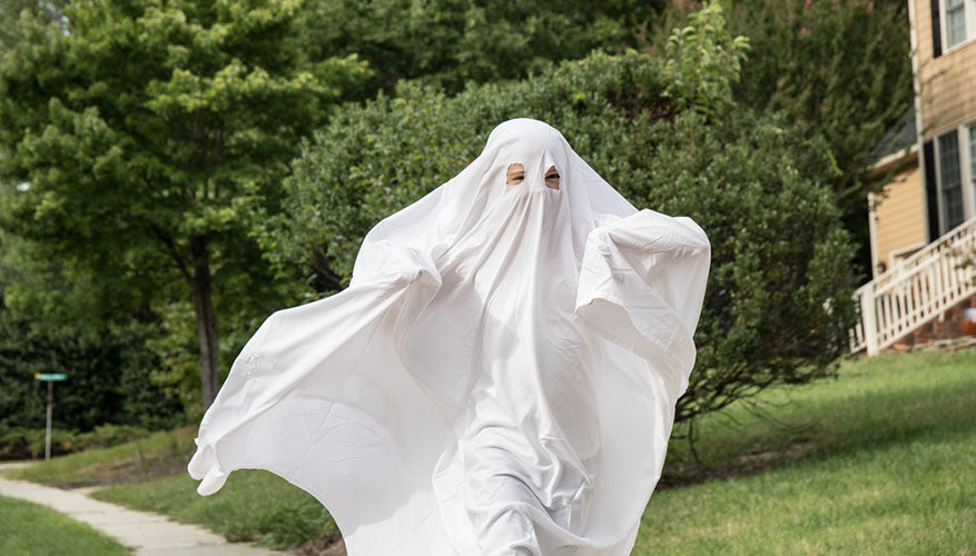 running in white sheet ghost costume