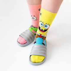 A woman wearing SpongeBob socks and slide sandals