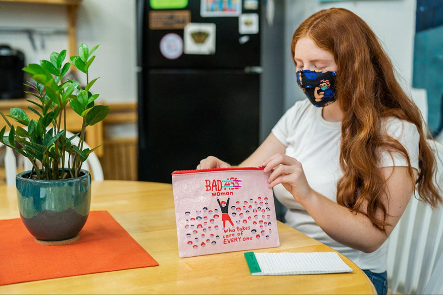 student wearing face mask at desk